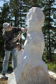 John Fisher roughs out his sculpture