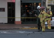 A Santa Barbara city fire captain uses a thermal imaging camera as crews respond to an underground electrical vault fire (April 5, 2012)