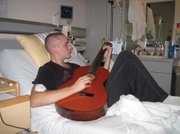 Zack Hansen, son of SOhO Restaurant & Music Club owners Bob and Gail Hansen, spent a large chunk of his hospital stays playing guitar. This Thursday, Zack will play SOhO as part of an all-star benefit concert to help with the cost of his medical bills.