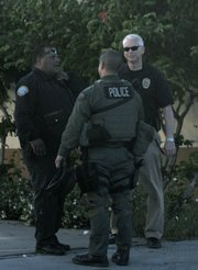 SBPD personnel responds to reports of a woman with a handgun barricaded inside her Milpas Street apartment
