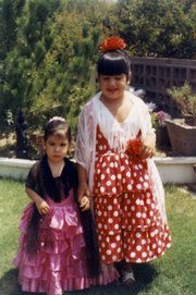The author's family has been involved in Fiesta for generations. Her daughters Laura and Debbie were decked out in 1971.