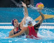 Kami Craig (left), Santa Barbara's gold medalist at the London Olympics, during the U.S. team's match against China.