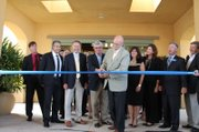 Goleta Mayor Ed Easton mans the scissors during a ribbon-cutting ceremony for the city's new Courtyard by Marriott hotel