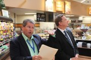 Rick Crandall, Supervalu's Director of Environmental Stewardship (left), and David Danielson, U.S. Assistant Secretary of Energy, at the Carpinteria Albertsons