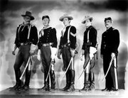 "Harry ""Dobe"" Carey (second from left) on the set of John Ford's 1949 <em>She Wore a Yellow Ribbon</em>, with John Wayne (far left) and others."