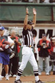 Veteran NFL field judge Gary Cavaletto signals a touchdown.
