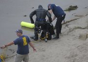 FBI agents search the scene were Christopher Marks's body was found (October 3, 2012)