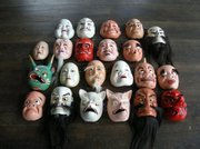 Kagura performers wear traditional hand-carved masks that, with their grotesque features, represent the Shinto divinities.