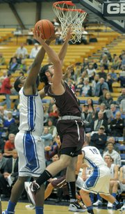 "UCSB's ""Big"" Al Williams blocks Westmont's Marcus Farrand's layup."