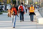 Perry Cabugos (volunteer), Maggie Cote RN (volunteer), Dr. Jason Prystowsky (volunteer) walking on street rounds
