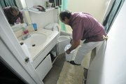 A Dario Pini tenant says he empties a wastebasket full of water twice a day from a leak under the sink. (Dec. 12, 2012)
