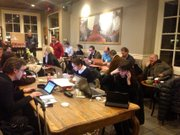 Reporters fill a Starbucks in Newtown