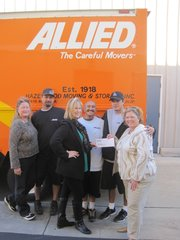 (From left to right) Carolyn Schuit, Hazelwood Allied; Larry Pearson, Hazelwood Allied, Mary Crowley, McCann Mini-Storage Manager; Erik Juan and Kelly Davis, Hazelwood Allied; and Tracey Lavery-Beard of Foodbank of Santa Barbara County receiving $1,000 donation from Hazelwood Allied and launching a unique community partnership.