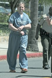 It's this safety dilemma that county officials hope to eliminate by building a new criminal courthouse: having to walk inmates back and forth between the historic courthouse and the Figueroa Division. Pictured here is convicted murderer Corey Lyons being walked across the street following his sentencing hearing.