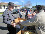 Erik Talkin (left) at the Franklin Community Center food distribution