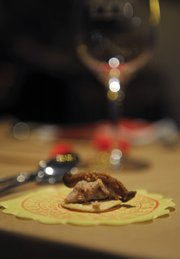 The Chinese New Year dinner began with rillettes over rice crackers with shiitake mushrooms and mustard seed.