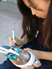 Yuliana Salazar painting the music shoe