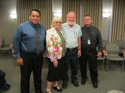 HR Manager Gabriel Garcia, GM Sherrie Fisher and Operations Manger Bill Morris (right) honor 40-year employee Clarence Suhr.