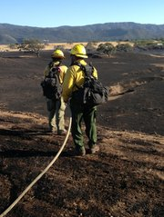 Crews mop up after the Olive Fire in the Santa Ynez Valley