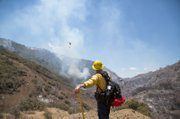 Safety officer watches fire fighting effort near Camuesa Connector.