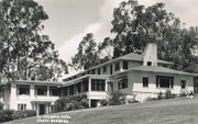 An old postcard shows El Encanto's main building as it looked years ago.