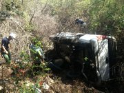 A crew works to remove the truck discovered July 4th at the bottom of a steep ravine off Paradise Road