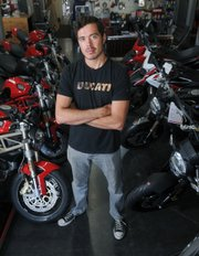 <b>MAKING HISTORY:</b>  Five years ago, S.B. motorcycle racer Carlin Dunne (above) was a spectator at his first Pikes Peak Hill Climb. Now he is a three-peat winner of the race, this year achieving victory on an electric motorcycle.