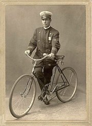Stamford police officer Arnold Kurth poses with his bike, 1892.
