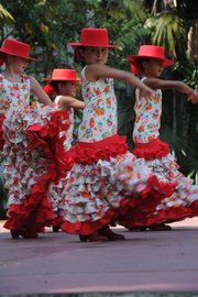 <b>LITTLE BLOOMS:</b>  Fiesta Flower Girls serve as official greeters, participate in the parades, and perform at the Old Mission opening night.