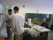 Moving out of the old sanctuary offices at the S.B. Harbor are Todd Jacobs (left), Sean Hastings, and Ben Waltenberger.