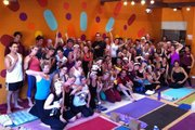 "Power Your Om Yoga students flash gang signs during their ""Namaste With Attitude"" class"