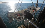 <b>ANCHORS AWEIGH:</b> Zach Randell launches a USGS boat from Point Conception.