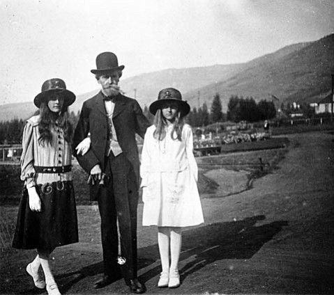 <b>THE CLARK SISTERS IN BUTTE:</b>  Andrée (left) and Huguette pose with their father, Sen. William Clark, on the site of Columbia Gardens, the public park he donated to the citizens of Butte, Montana.