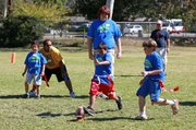 <b>PLAYING PIGSKIN:</b> Youngsters in the Challengers FlagFootball program got their kicks this fall.