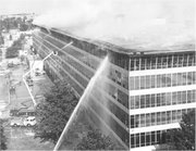 Firefighters battle the blaze that engulfed much of the National Personnel Records Center in 1973.