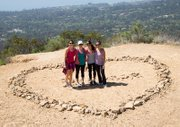 Local college students pose at Lover's Knoll on the Saddle Rock Trail.
