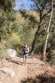 Trail runner enjoying the newly-opened Creekside Trail