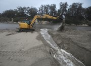 Crews dug a trench east of Goleta Beach to release flooding in the slough, airport, and surrounding areas.