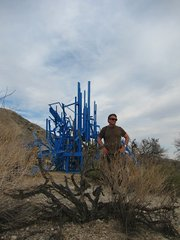 "BIG BLUE:  Author Charles Donelan with Gustavo Godoy's Ranch Project ""Big Blue"" (2010-2013), which combines a wooden structure with blue paint and LED lights."