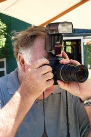 <b>PERMA-LENS:</b> This is usually what winecountry photographer Bob Dickey looks like at the various events around the region.