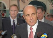 David Lack (left) stands behind then presidential candidate Rudy Giuliani (Sept. 27. 2007)