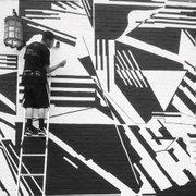 Students assist muralist Rafael Vargas-Suarez on a piece at the Hotel Indigo.