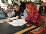 Danny helps Crystal on her professional portfolio.