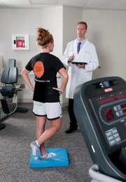 Dr. Jay Alberts evaluates an athlete in the lab.