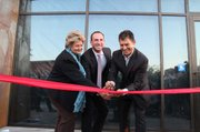 <b>ISLA VISTA DREAMING:</b>  Assemblymember Das Williams (right) and Supervisor Doreen Farr help Neil Dipaola cut the ribbon at the opening of the LOOP in I.V., which Governor Jerry Brown called the greenest development on the Central Coast.