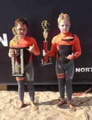 Twin brothers Hamilton, left, and Curtis Jacobs show off the hardware they won at the NSSA Gold Coast Conference meet at C Street in Ventura.