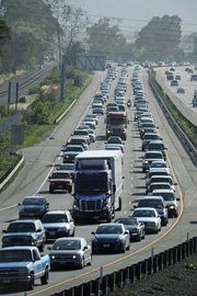 <b>GRIDLOCK: </b> One week, the city council voted to sue over the freeway widening plan; the next week, it backed down.
