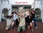 The crew or Samy's with their favorite toys outside the new location at 530 State Street.