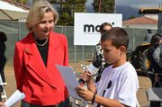 Congressmember Lois Capps and a student at the MOXI groundbreaking