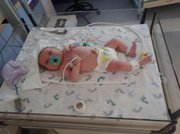 NICU babies spend many days hooked up to monitors and IVs.